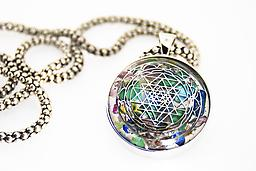 103-Elite Pendants Silver These solid silver pendants include a high quality silver chain. The elite gemstones are selected based on your personal birth time and place of birth. Choose our own favorite sacred geometric symbol.