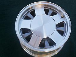 (4) New Take Off 15x7 OE Chevy Express G1500 GMC Savana 1500 Alloy Wheels This is a new take off set with less than 10 miles on them. Removed from a 1997 Conversion van, they have been boxed and on a shelf. Includes the center caps.