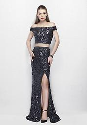 Primavera 3095 in Charcoal This dazzling duo features an off-the-shoulder sequin top, with a full-coverage back, and zipper closure. The matching sequin column skirt highlights your stunning figure, and has a side slit.