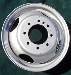 """16"""" Dodge Dually Steel Rim This is a new (old stock) Dodge ram dual wheel. 16"""" steel. Never been mounted, but does have some scuffs from storage (as shown). Fits the Dually trucks 94 95 96 97 98 99. Painted. Wheel # 2125"""