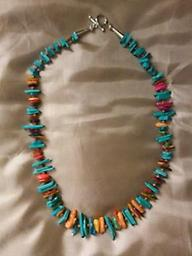 AVAILABLE ~ Multi Gem, multi colored Necklace This multi-gem, multi-colored necklace is approximately 21 inches long and composed of many different color chips. A beautiful gift that everyone will notice.