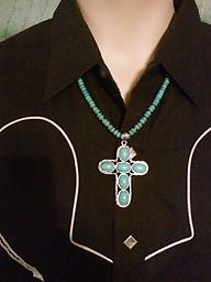 """""""'Turquoise' Cross Necklace"""" Approximate 22 inches long with silver fittings & trim, turquoise & silver colored beads. The cross pendant is approximately 2 inches wide by 2.75 inches long. Great gift for any age. ONLY ONE"""