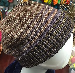 Quixotic Hat Learn to knit in the round on circular needles and finish with double pointed needles. Choose your favorite color of this oh-so-fun self-striping yarn.