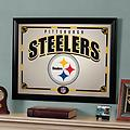 Steelers Framed Mirror - Printed mirror Pittsburgh Steelers collection Color: Multi Material: Wood and Glass This framed mirror is a wonderful combination of design, form and function It boasts brilliant team colors and logos