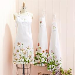 """Floral Apron Gift Set Great gift for the flower arranger in your life! These sweet aprons, which say """"Live Life in Full Bloom"""", come folded in an adorable ceramic mug, that mimics a terra cotta flower pot."""