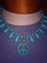 1 PEACE NECKLACE AVAILABLE The Peace Necklace is approximately 19 inches long with the peace symbol pendant approximately 1.25 inch diameter.