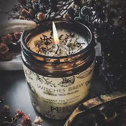 Witches Brew CANDLE, Comes in a 9oz amber jar filled with 7oz of magical coconut wax.