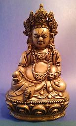 Dzambhala - Tibetan God of Wealth. Boldly detailed image of the God of Wealth measures about 9 inches tall, about 6 inches wide, and 4 inches deep. [only one available]