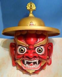Dorje Legpa Dance Mask, Fiberglass (Chengdu, China) Modern Tibetan lama dance mask, made for use out of light-weight fiberglass in Chengdu, China. This large mask measures about 22 inches tall, hat brim 16+ inches across. [only one available]