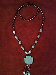 "TURQUOISE NECKLACE WITH CROSS PENDANT - Turquoise cross pendant necklace, approximately 30 inch long loop and cross pendant is 1.25"" square & with dangles adds 3 inches. Beads are black and gold and this necklace attracts attention."