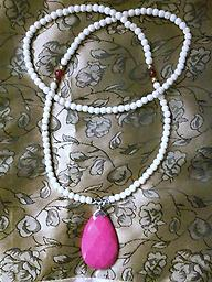 """Beautiful Fuchsia Pendant Necklace"" This Beautiful off-white, beaded, handcrafted necklace is approximately 30 inches long with a Fuchsia colored pendant approximately 1.25 inch wide by 2.25 inches long. Simply awesome!!!"