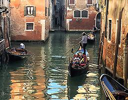 """Venetian Gondoliers 8"""" x 10"""" print Classic image of transportation in the beautiful multi-colored city of Venice, Italy captured through Nancy Guthrie Pierce's lens."""