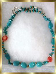 B9 SOUTHWEST TURQUOISE & 'ROSE' NECKLACE This beautiful handcrafted beaded necklace is approximately 20.5 inches long and has two 'rose' beads. Bound for attention.