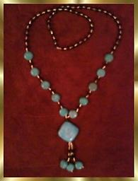 C5 TURQUOISE NECKLACE TURQUOISE NECKLACE, neck loop 30 inches long. Turquoise pendant is approximately 3 inches long, with Turquoise, Black & Gold Beads