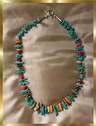 A2 Multi Gem, multi colored Necklace This multi-gem, multi-colored necklace is approximately 21 inches long and composed of many different color chips. A beautiful gift that everyone will notice.