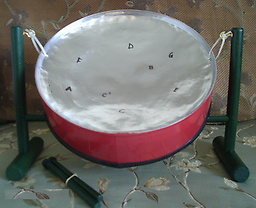 8-Note Mini Pan (Silver/Red) Mini steel drum,, in the key of C major. Silver top and red side.