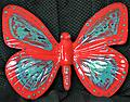 Red/Green Butterfly - Beautiful and whimsical, perfect for the garden, this will definitely give your guests something to talk about.