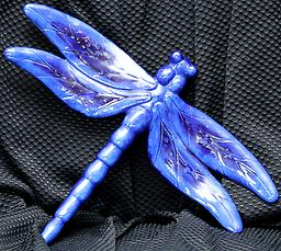 Blue Dragonfly Dress up your garden with a unique and beautiful piece of art. These amazing dragonflies come in an assortment of colors and crystals and are UV protected so the color will not fade.