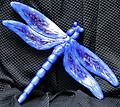 Blue Dragonfly - Dress up your garden with a unique and beautiful piece of art. These amazing dragonflies come in an assortment of colors and crystals and are UV protected so the color will not fade.