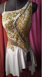 White and Gold Dance Dress White dance dress with nude mesh cutouts, gold beaded sequined appliques and crystal ab Swarovsky crystals. Additional photos in shop section.