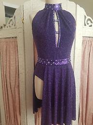 Purple Glitter Dance Dress Glitter slinky dance dress with flared panel skirt, metallic purple belt, collar and trim. Embellished with Amethyst AB Swarovsky Crystals.