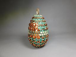 """Traditional Transformations Black Ash, Sweetgrass, Copper, Rit. Basket Contains a vial with an Emerald Ash Borer in it, on black velvet. 9"""" height x 4 1/2"""" Diameter"""
