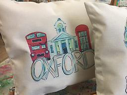 Oxford Courthouse Throw Pillow The Oxford Courthouse Throw Pillow is 17 x 17 inches with a zip closure. The original print is hand painted by @artbyskd. Pillow includes 16 x 16 inch stuffer.