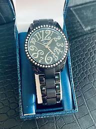 Ladies Speidel - Black Speidel Womans black watch with a large face and metal band with folding clasp