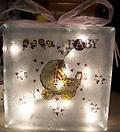 Baby Night Light B - Block is decorated with Baby Carriage on the front and flowers and Baby Girl and Toddler Figures on the back.