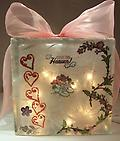 "Baby Night Light D - Block is decorated with Booties, Hearts and Flowers on Front, VERY girlie. Back says Baby Girl, has butterflies and ""Diva"" toddler figures all over it!"