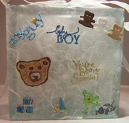 Baby Night LIght G Block is decorated with a baby carriage on one side and features teddy bears on the other side.