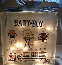 "Baby Night Light H Block is decorated with baby carriage on the front and ""Baby Boy"" and Trains on the back."