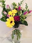 Sweet Splendor - This stunning bouquet is sure to make anyone smile! Cheerful Gerbera daisies, spring tulips, campanula, snapdragons and hypericum berries are playfully combined in this arrangement.