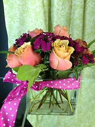 Modern Roses This modern twist on a rose arrangement is unique in design and style! 'Cherry Brandy' roses and hot pink sweet william are tightly arranged to create this stunning display!