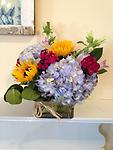 Brighten your Day - This cheerful modern cube style arrangement of blue hydrangea, sunflowers, campanula and sweet william are a perfect gift for any occasion.