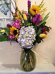 French Countryside - This striking arrangement of hydrangea, forsythia, tulips, liatris, stock, heather, sunflowers and hypericum berries are perfect for any occasion.