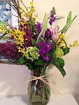 Spring is Coming! - This lively selection of forsythia, stargazer lilies, stock, hydrangea and heather are sure to lift anyone's spirits.