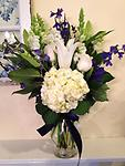 Peaceful Thoughts - Sending flowers is a special way of showing compassion and sympathy in your friend's time of need. This bouquet of hydrangea, delphinium, roses, lilies and snapdragons is sure to send comfort.