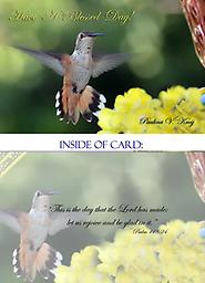 HH1309GC Have A Blessed Day - Greeting Card This beautiful female hummingbird wishes you a blessed day. She is in full flight with her wings outstretched. She hovers over yellow flowers as she stops to sip a little nectar.
