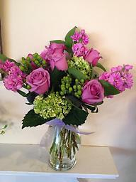Garden Walk This charming bouquet of lavender roses, stocks, green hydrangea and green hypericum berries is reminiscent of strolling through beautiful gardens. Fragrance and beauty combine perfectly.