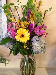 """Rustic Charm This stunning combination of hydrangea, gerbera daisies, liatris, stock and bells of Ireland are the perfect """"pick me up"""", and sure to brighten anyone's day."""