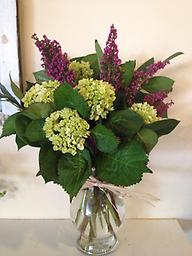 Simple Elegance Bright chartreuse green hydrangea and heather are simple and elegant in this stunning combination. Whatever the occasion, this is sure to please.
