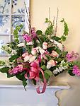 Loving Sympathy - This heartwarming garden style basket is appropriate for a lost loved one, friend, or colleague. Feminine in style, it's combination of roses, bells of Ireland, and stock, will show your compassion.