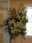 Blooming Spring Standing Spray - This bright standing spray is a fitting way to celebrate the life of that special person. Hydrangea, roses, lilies, snapdragons, tulips and forsythia combine gracefully for a fitting last tribute.