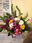Thoughts of Spring Basket - This garden style basket arrangement is sent to the funeral home, and can be taken home by the family. Bells of Ireland, gerbera daisies, phlox, liatris, daisies, roses and sweet william are gathered
