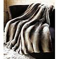 Grey Chinchilla Faux Fur Throw - Tourance Throws are made from the softest fabrics imaginable! Snuggly soft plush exteriors combine with silky smooth satin interioris to create a warm and cozy place to lounge. Treat yourself or give