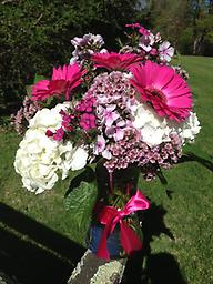 Good Day Bouquet! White and hot pink is a fabulous combination for anyone to show how much you care! Cheerful gerbera daises, white hydrangea and fragrant phlox make up this design.